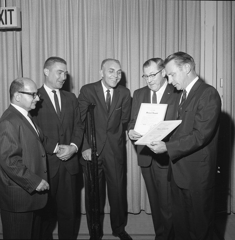 Photo courtesy Mr. & Mrs. Robert Markow  McLoughlin (second from right) receives the Hire the Handicapped Award in 1963.
