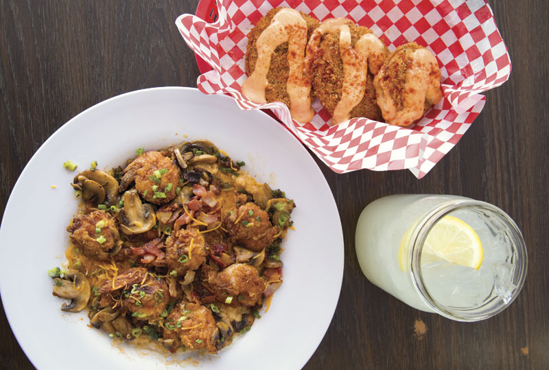 Photo by Brian Goddard; Shrimp and grits and fried green tomatoes at Lo-Lo's Chicken and Waffles