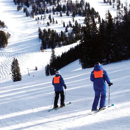 Ray skiing with his adaptive ski instructor, Katie Zinn