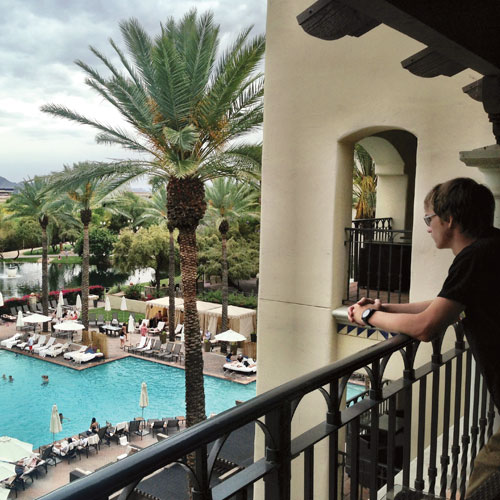 Dylan checking out the pool from our room