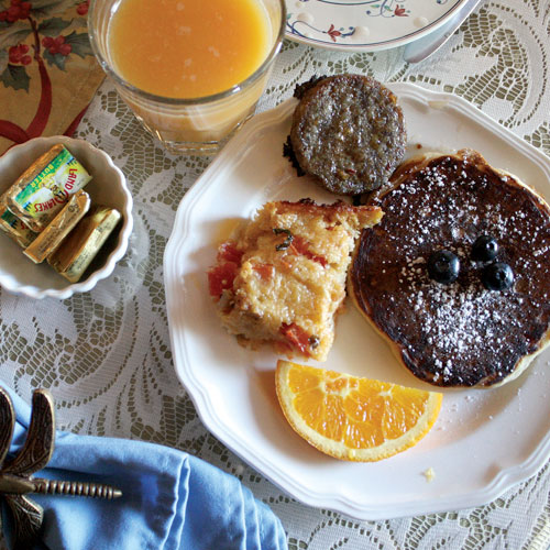 Homemade breakfast at The Inn at 410, including tomato quiche with locally foraged lobster mushrooms