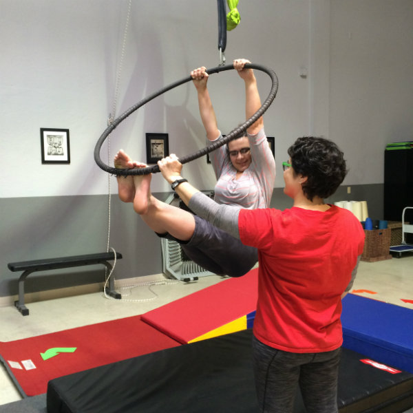 Leah holding on for dear life in the lyra aerial hoop.