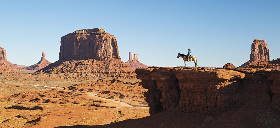 Horseback riding at Monument Valley Navajo Tribal Park; photo by Kevin Kaminski, model: Kelly Guido