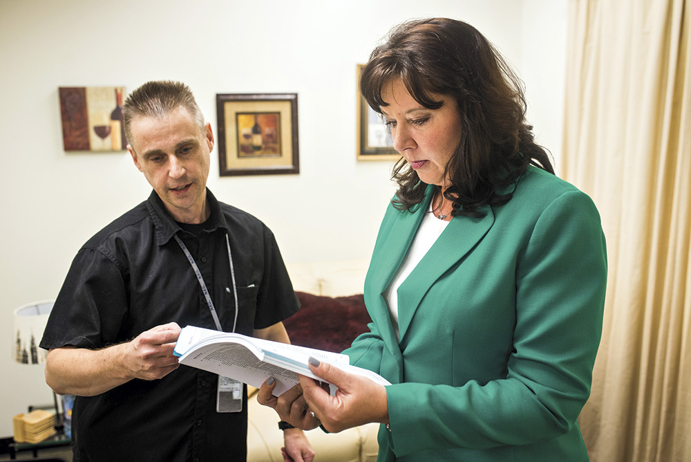 Reagan with Scott Cancelosi, director of administrative rules, in her office at the Arizona State Capitol in December 2017; Photography by Jill McNamara