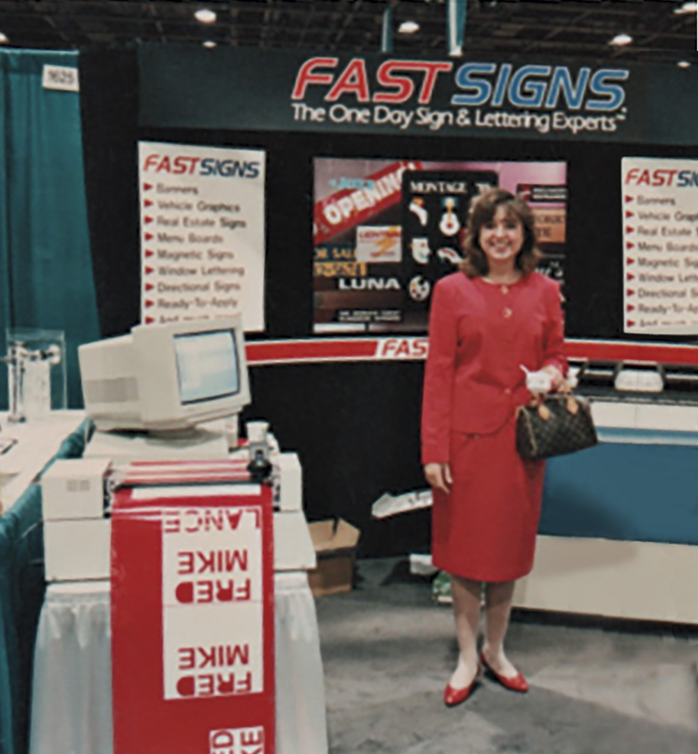 Reagan in 1992 at her familiy's first FASTSIGNS location; Photography by Jill McNamara