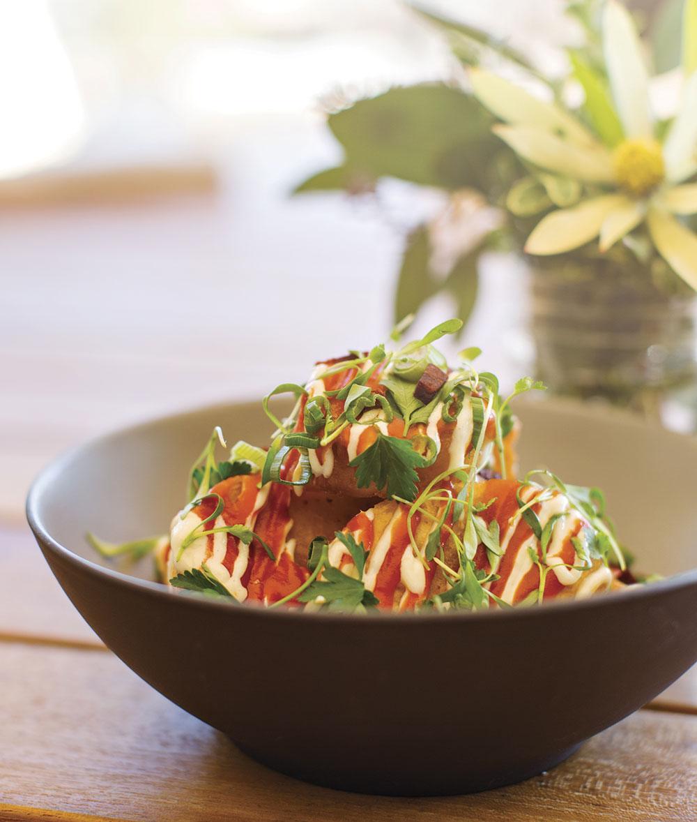 Crispy potatoes with chorizo and tomato brava hot sauce