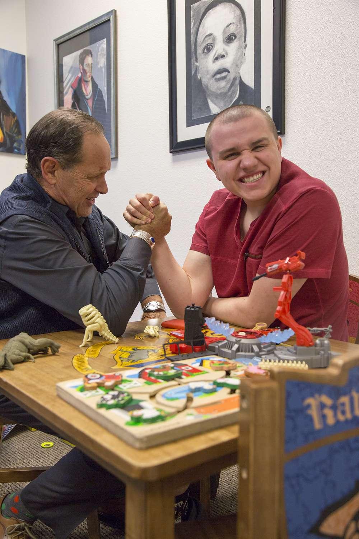 Dr. Raun Melmed arm-wrestles patient Matt Sedwick; photo by Jill McNamara