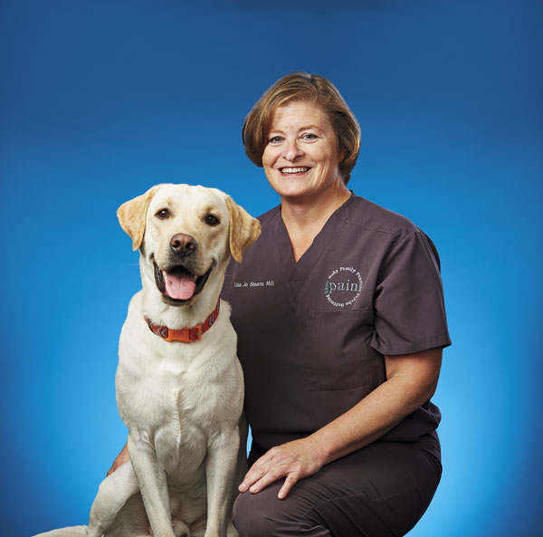 2018 Top Doctor: Lisa Stearns with therapy labrador Gringo