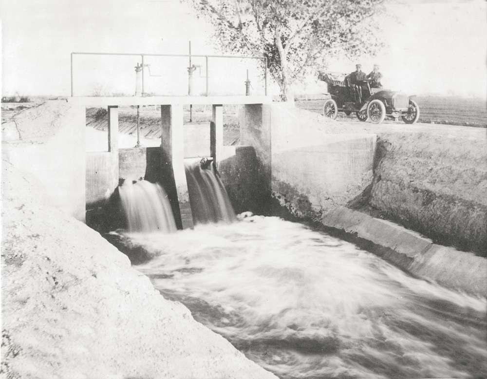 Locals kept cool by lounging in the mist of SRP's Grand Canal falls, 1909. Historical photos provided by Arizona Historical Society
