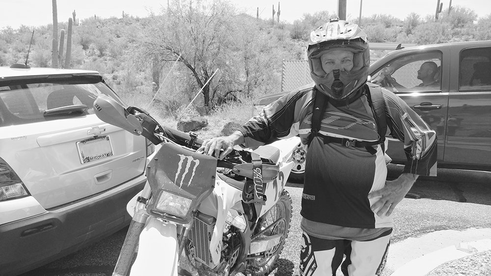 photo courtesy Mick Ohman; Troy Haverland with the dirt bike he used to carry Ohman to safety