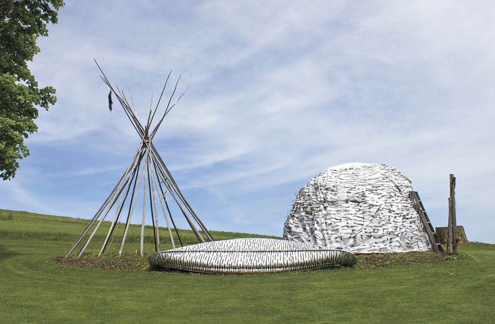 Photo by Leah LeMoine; Native American shelter re-creations at Henschel's Indian Museum