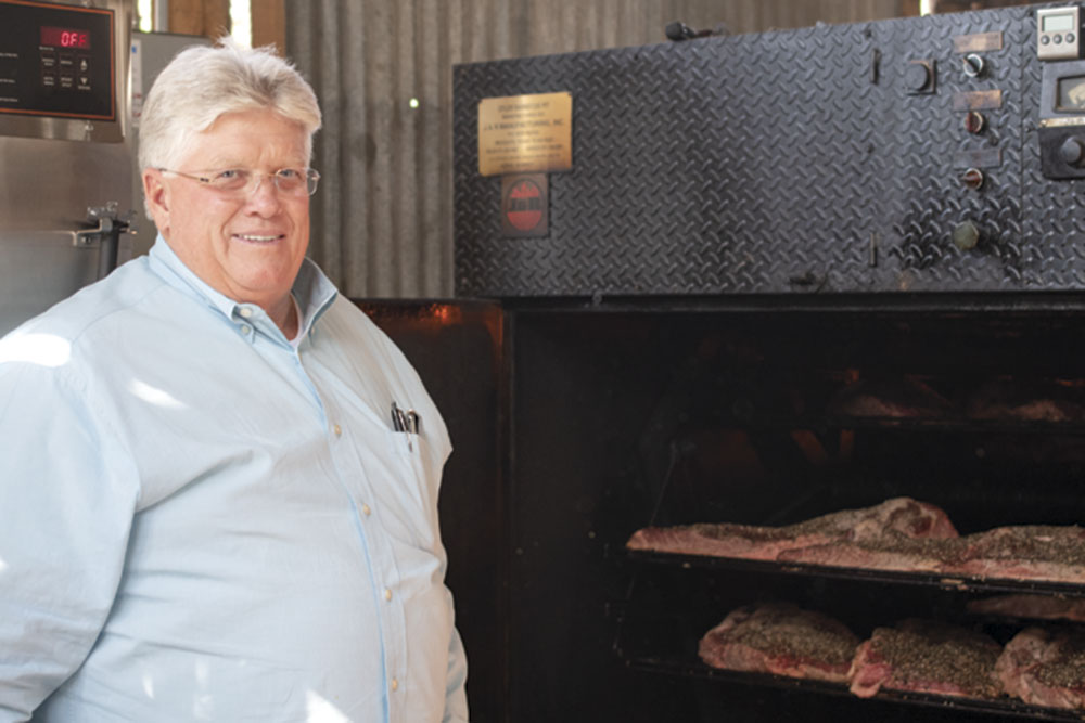 owner Duaine Burden with his smoker
