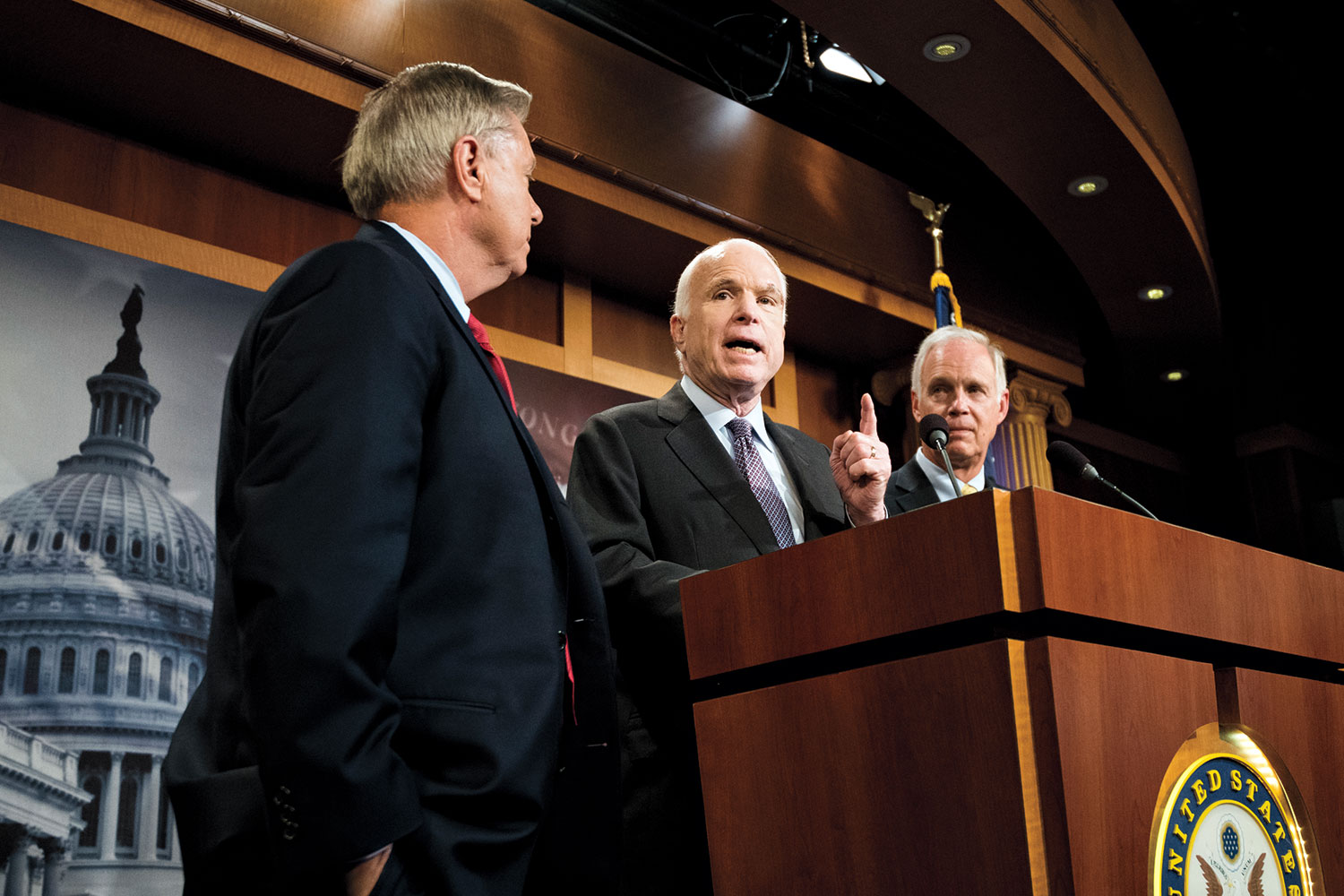 """From left, Sen. Lindsey Graham, R-S.C., McCain and Sen. Ron Johnson, R-Wisc., hold a press conference to demand assurances on the """"skinny"""" health care repeal bill in the Capitol on Thursday, July 27, 2017. McCain later cast the deciding vote killing the measure."""