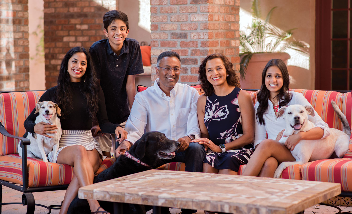 Photo courtesy Dr. Hiral Tipirneni; Dr. Hiral Tipirneni and her family at their home in north Glendale, 2017