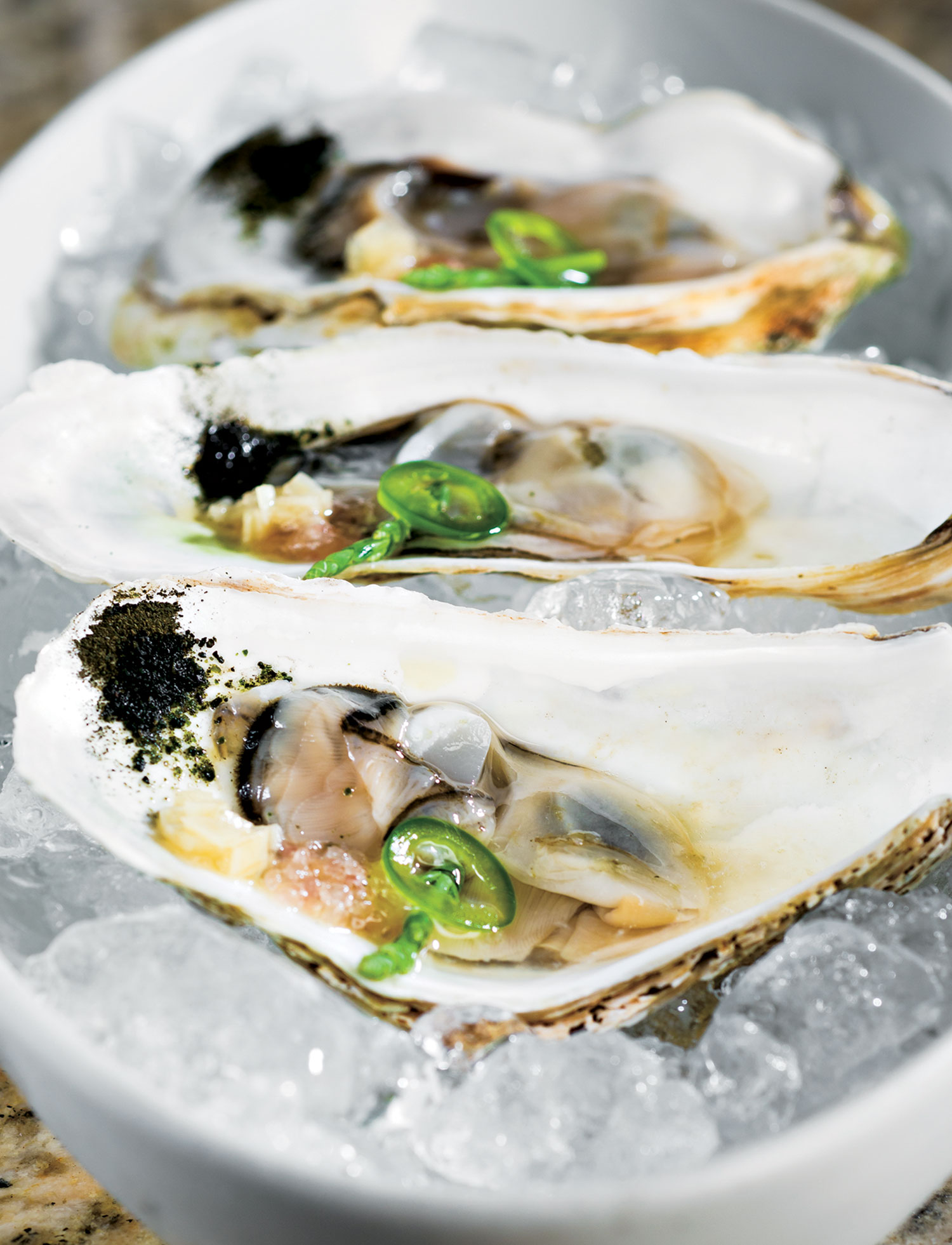 oysters with jalapeño; photo by Rob Ballard