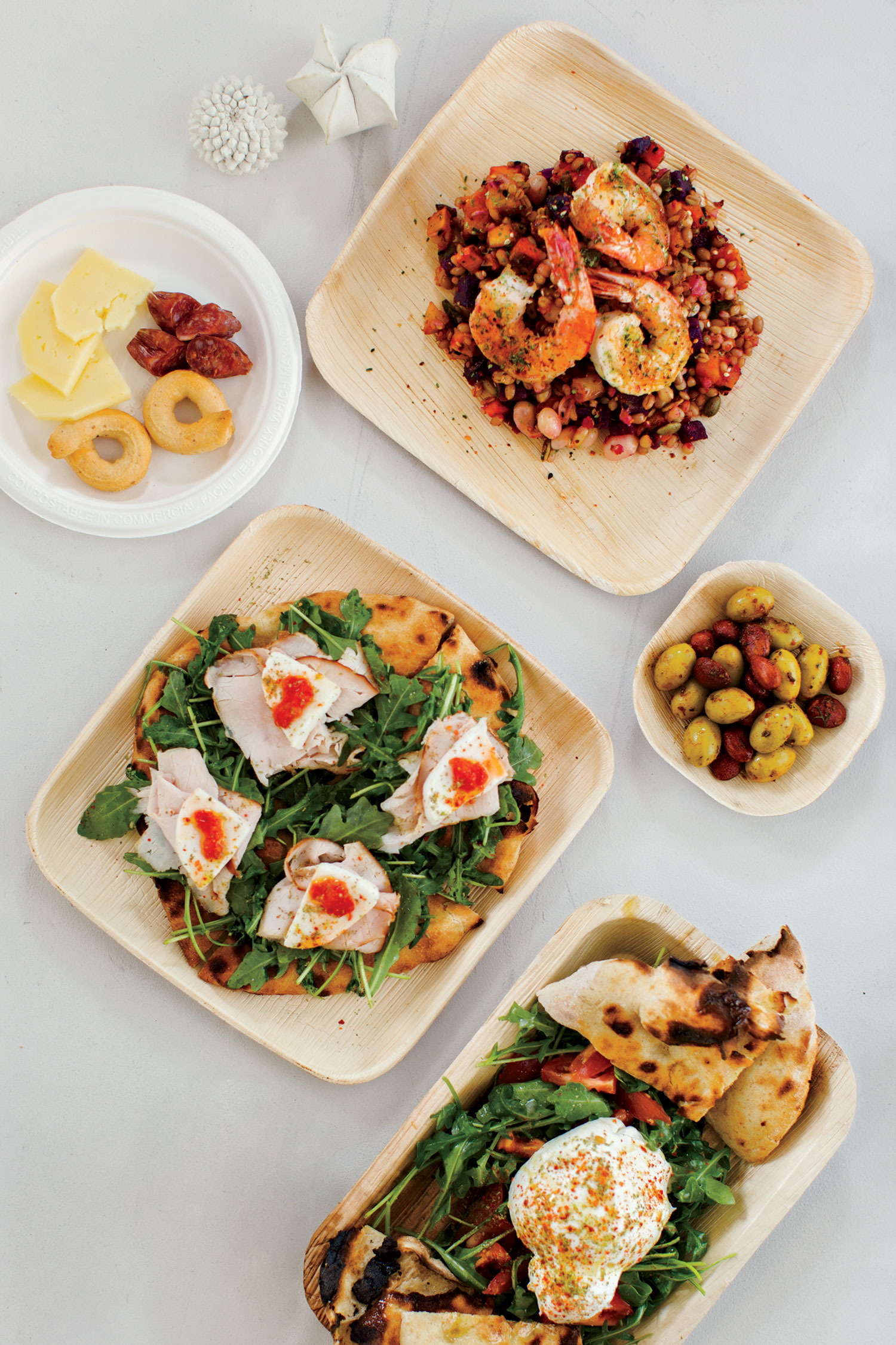 Mahón cheese and salametto; Navarro bowl with wild Guaymas shrimp; olives and spicy almonds; salad greens; schiacciata; Photo by Blake Bonillas