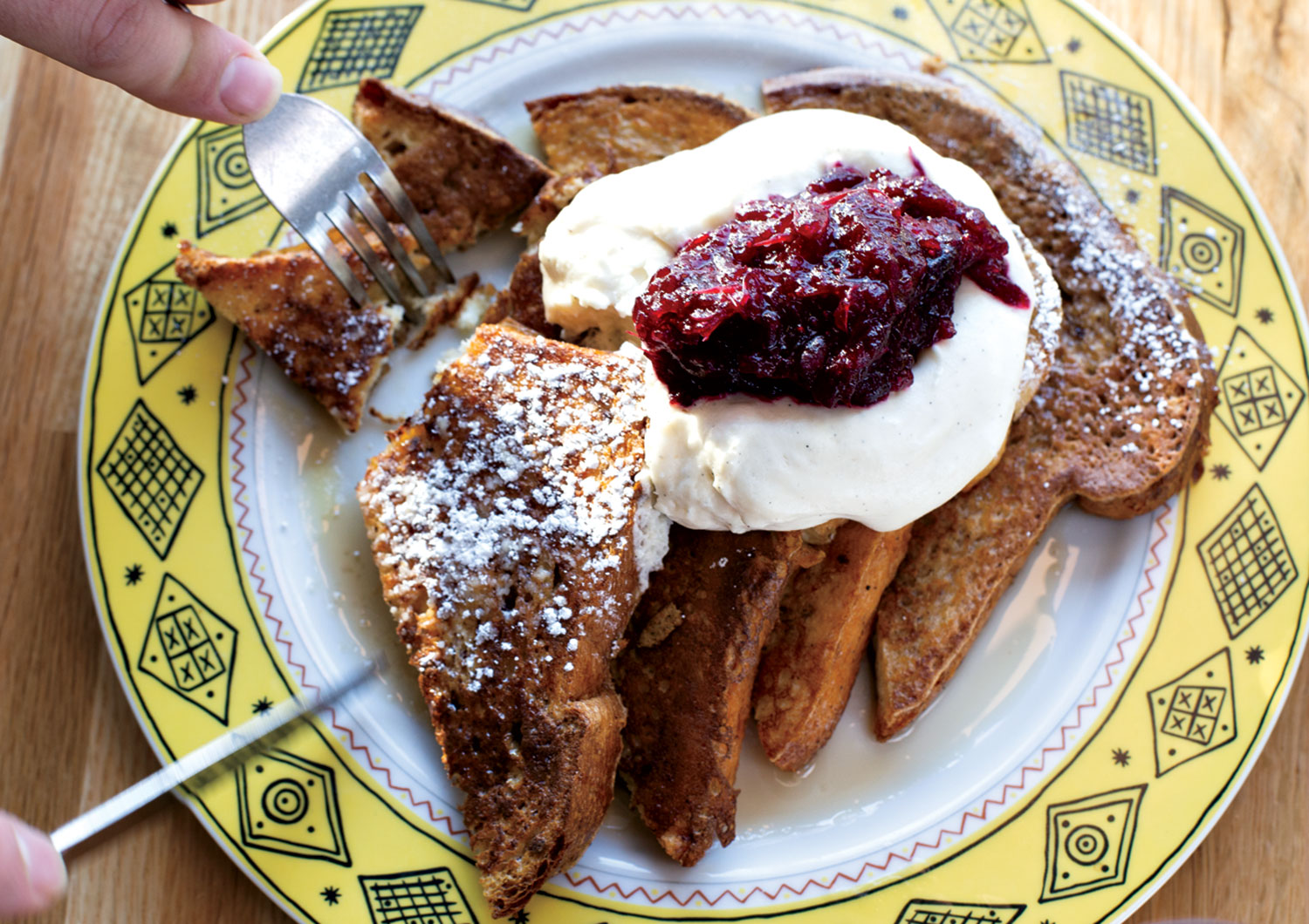 brioche French toast topped with fresh whipped cream and raspberry compote; photo by Debby Wolvos