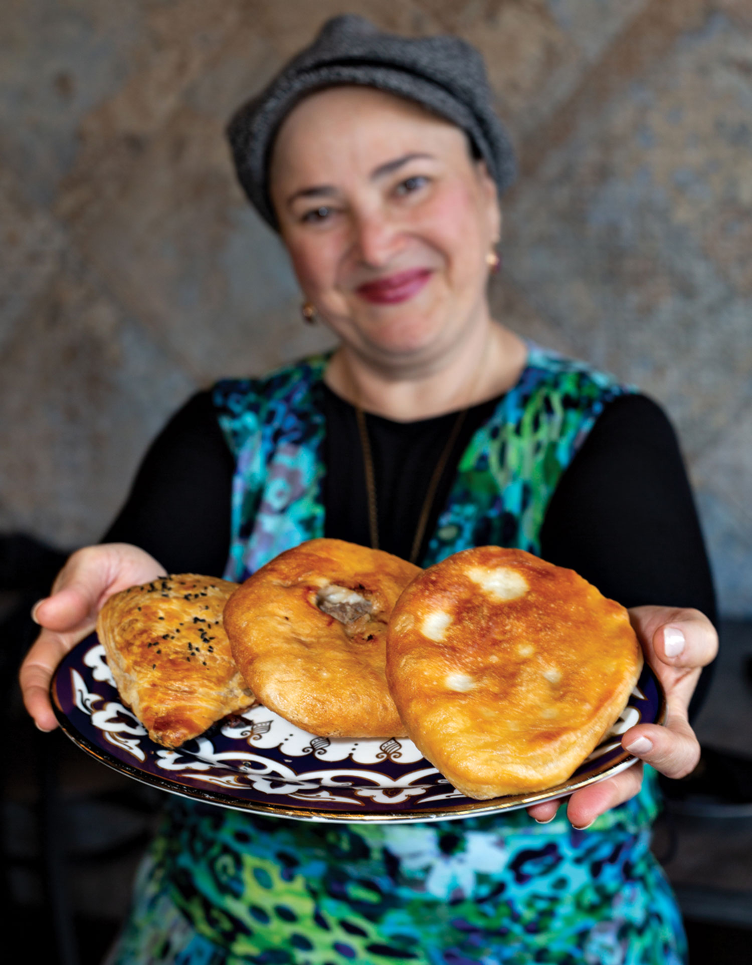 chef Mazal Uvaydova with her trio of savory pies; photo by Debby Wolvos