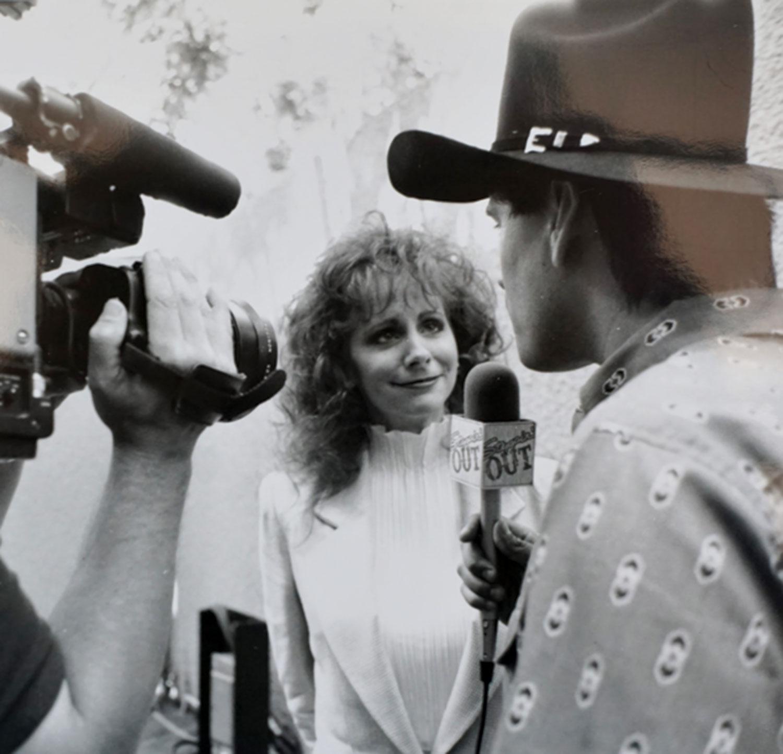 Host John Michaels interviews Reba McEntire, 1990s.; photo courtesy KNIX