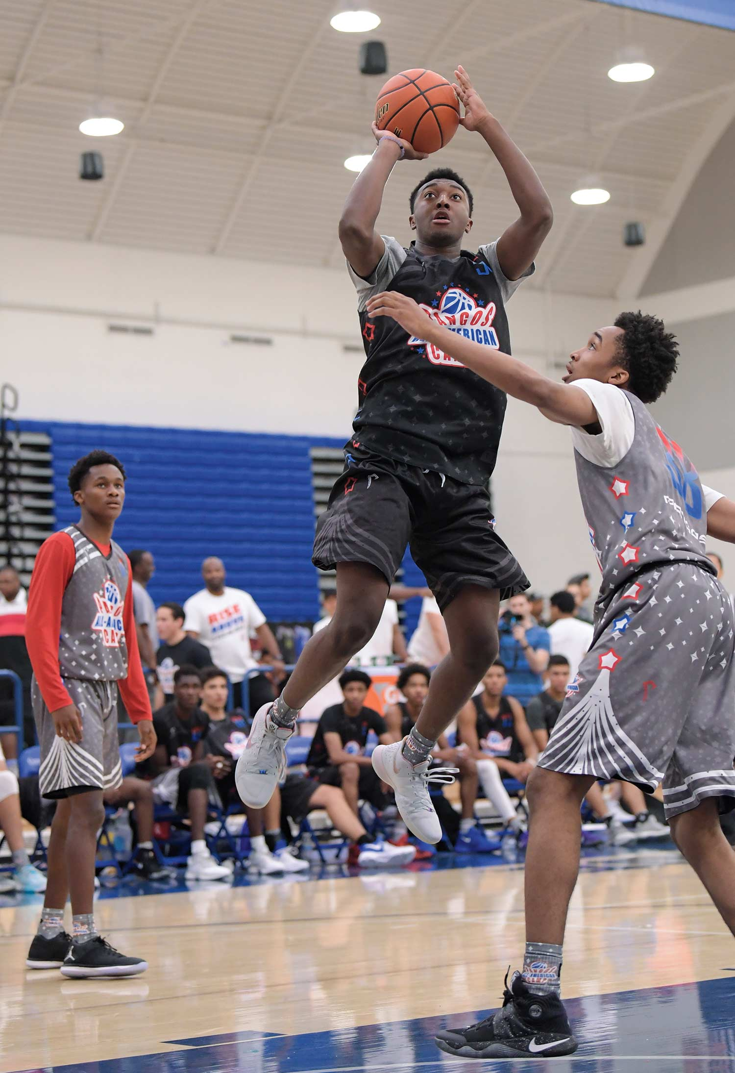 Photo courtesy AP Images; Hillcrest Prep forward Kyree Walker shoots at last summer's Pangos All-American Camp in Norwalk, California. ESPN ranks the junior scorer as the No. 3 player at his position in the class of 2020.