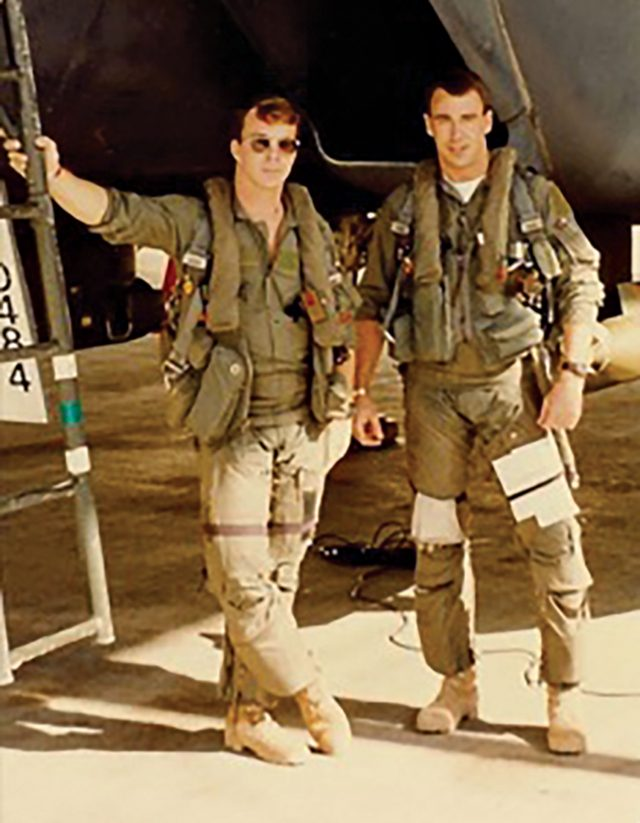 photo courtesy Brian Udell; Udell (right) in Iraq before a combat mission, 1990s