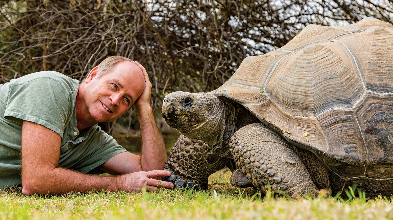 photo by Madison Kirkman; Jerry Fife (lounging with one of his wards) brought his first Galápagos tortoise to the Valley in 1994 and has since bred 2,000 of the once-endangered giants