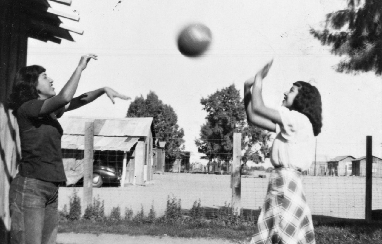 Nellie Ortega and Lucy Fimbres play ball in Hightown in the 1940s; Photo courtesy Douglas C. Towne