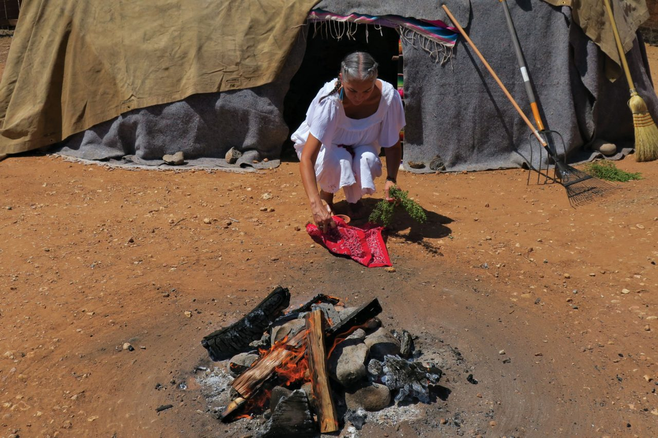 Felicia Cocotzin Ruiz collects her popoxcomitl, a tool to burn sacred tree resins and plants, after a ceremony marking her as a curandera in 2018; Photo courtesy Felicia Cocotzin Ruiz
