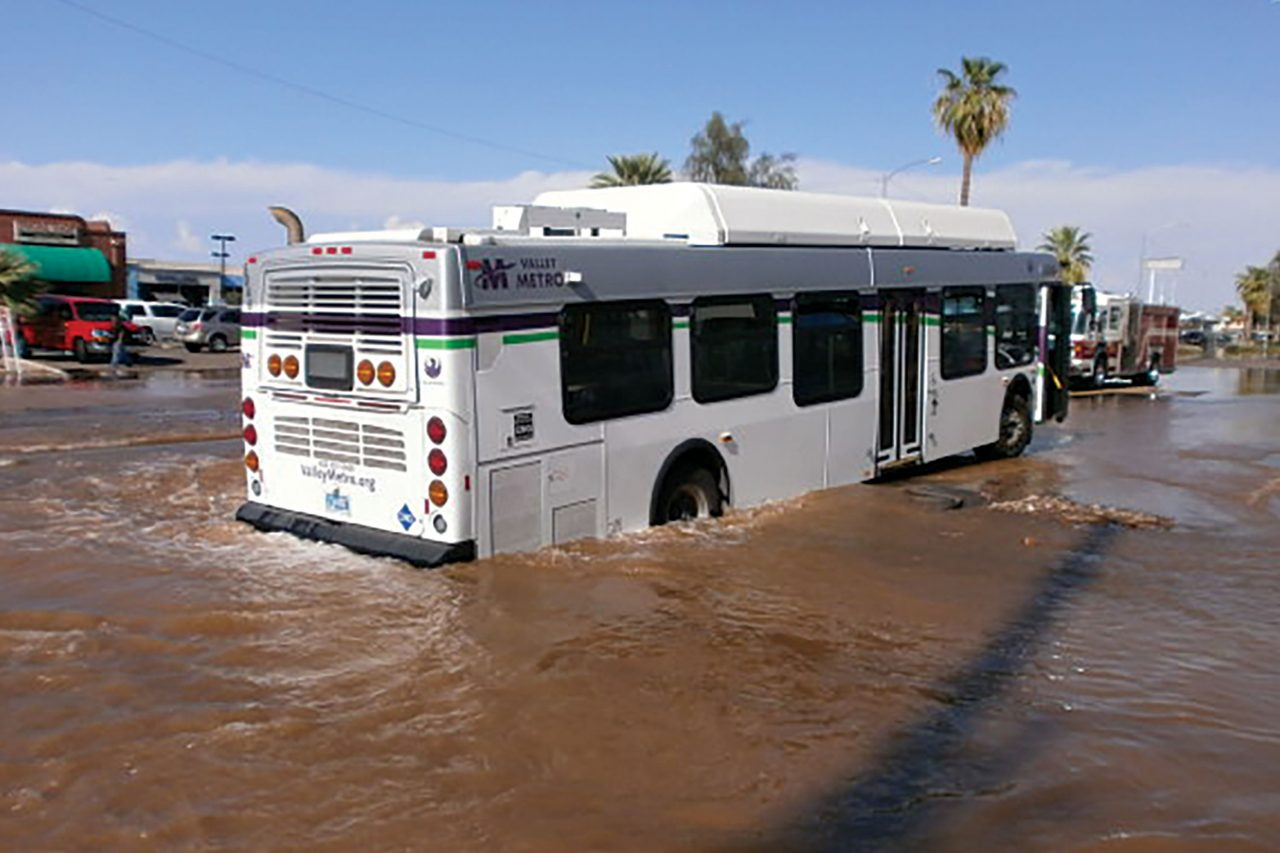 A city bus stuck in a sinkhole created by a water main break at 35th Avenue and Van Buren Street in 2016; Photo courtesy City of Phoenix