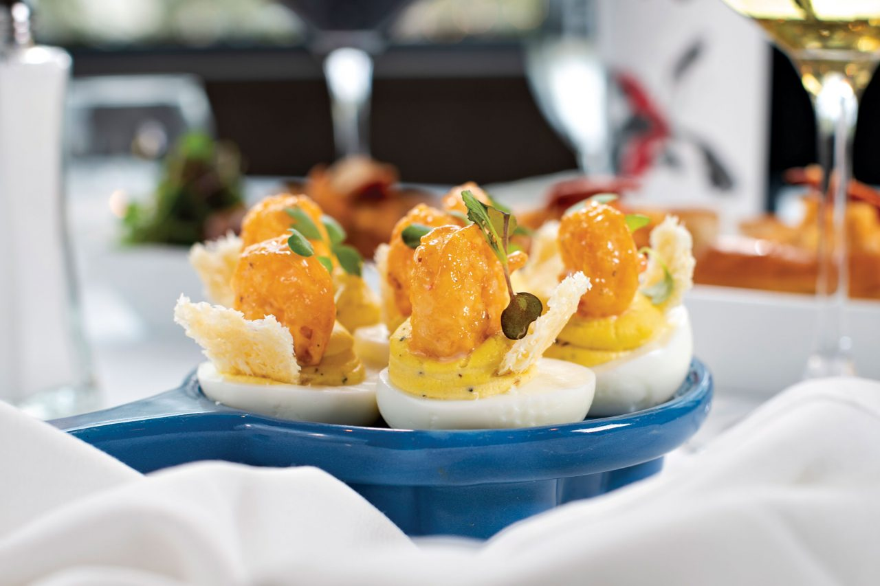 Deviled eggs with shrimp and Parmesan tuile