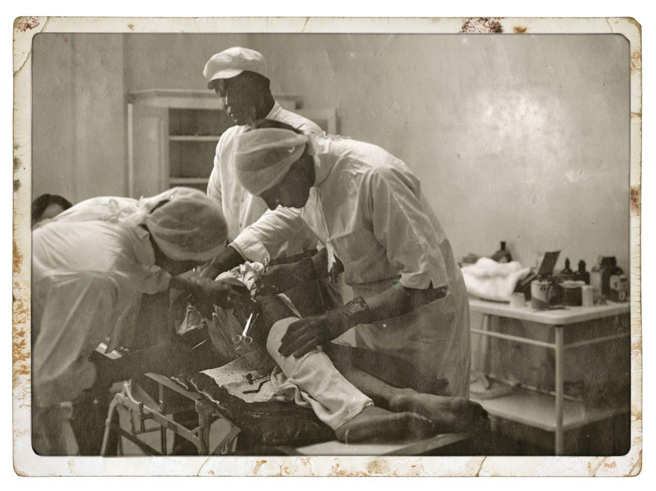Surgeons perform knee surgery at the Arizona State Prison Hospital, circa 1920s; Photo courtesy Arizona Historical Society