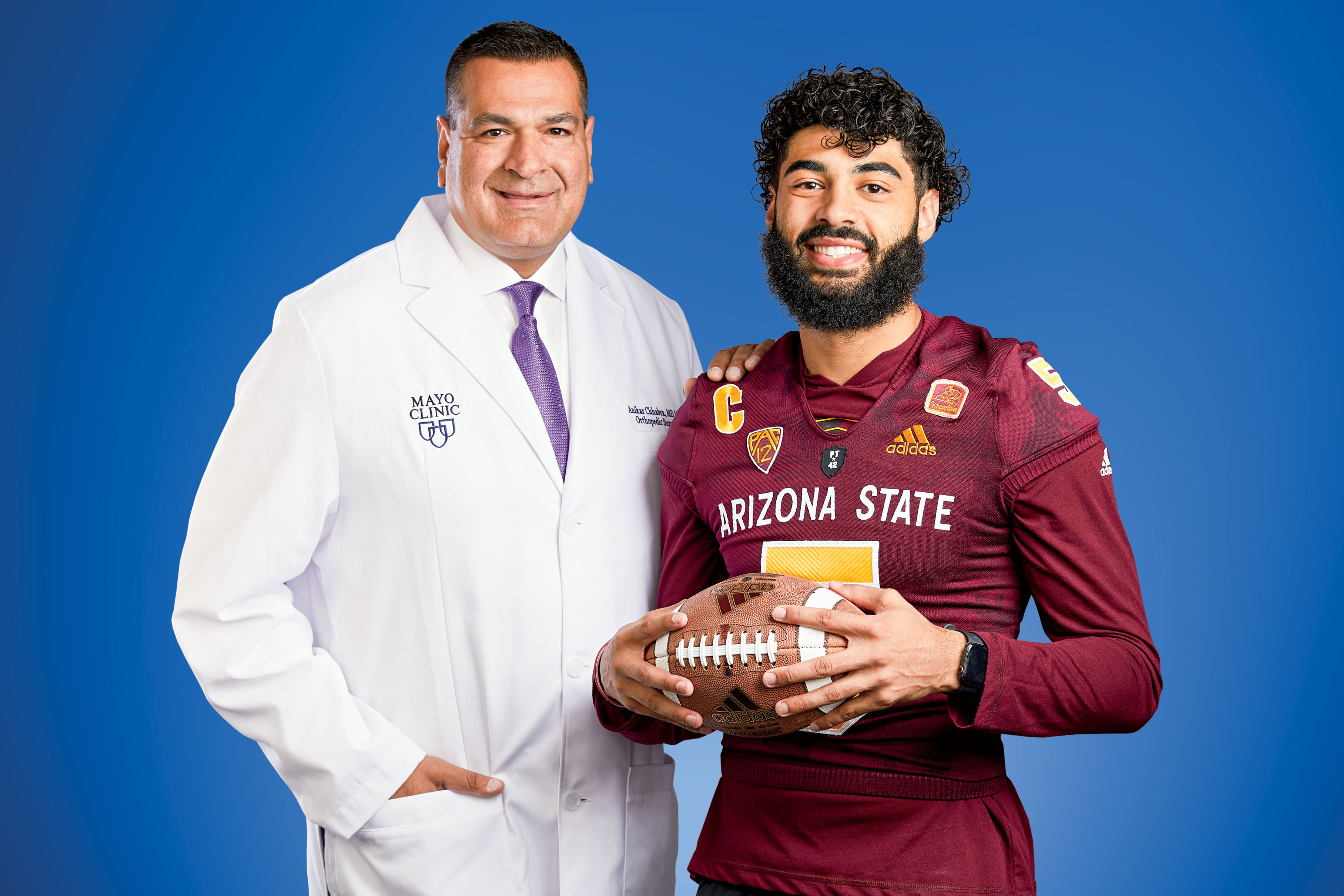 Dr. Chhabra with ASU quarterback Manny Wilkins; Photography by Steve Craft