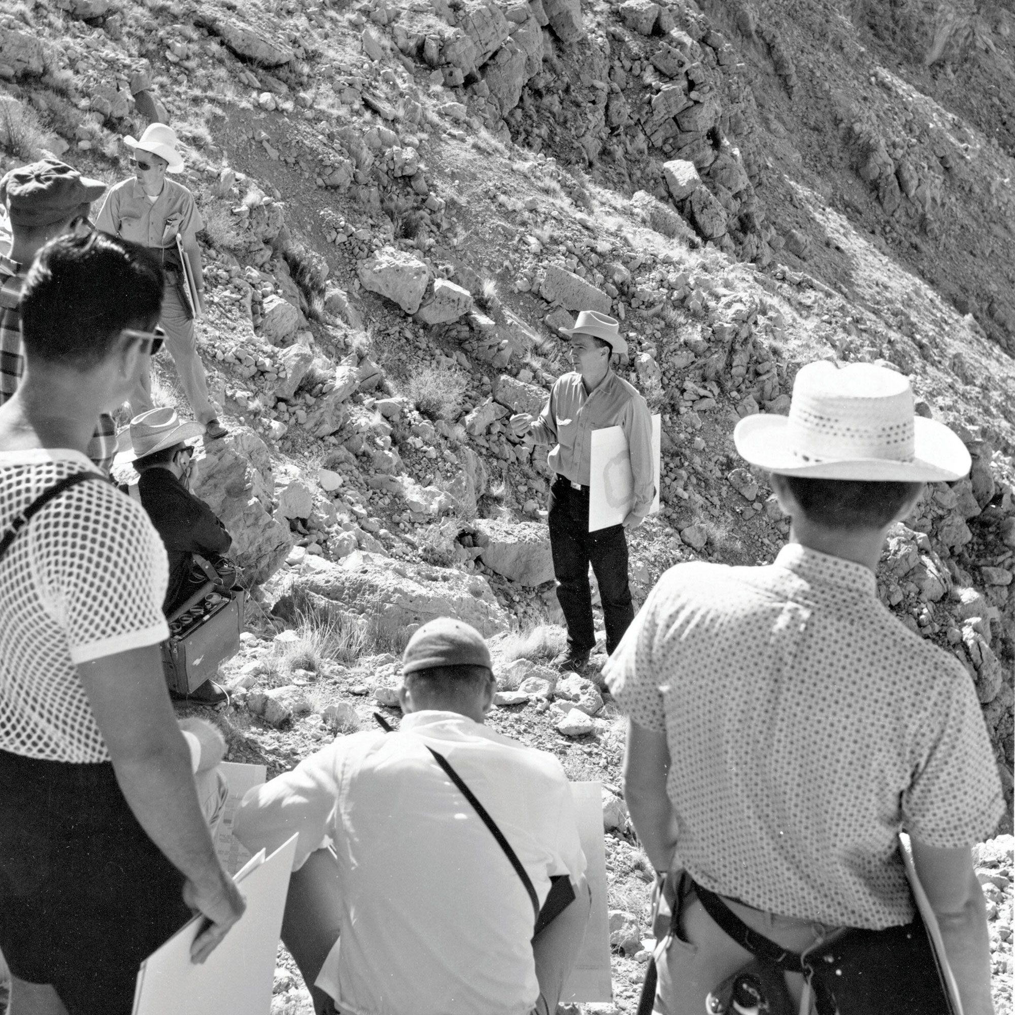 Shoemaker explains Meteor Crater's impact structures to astronauts during the 1967 trip.