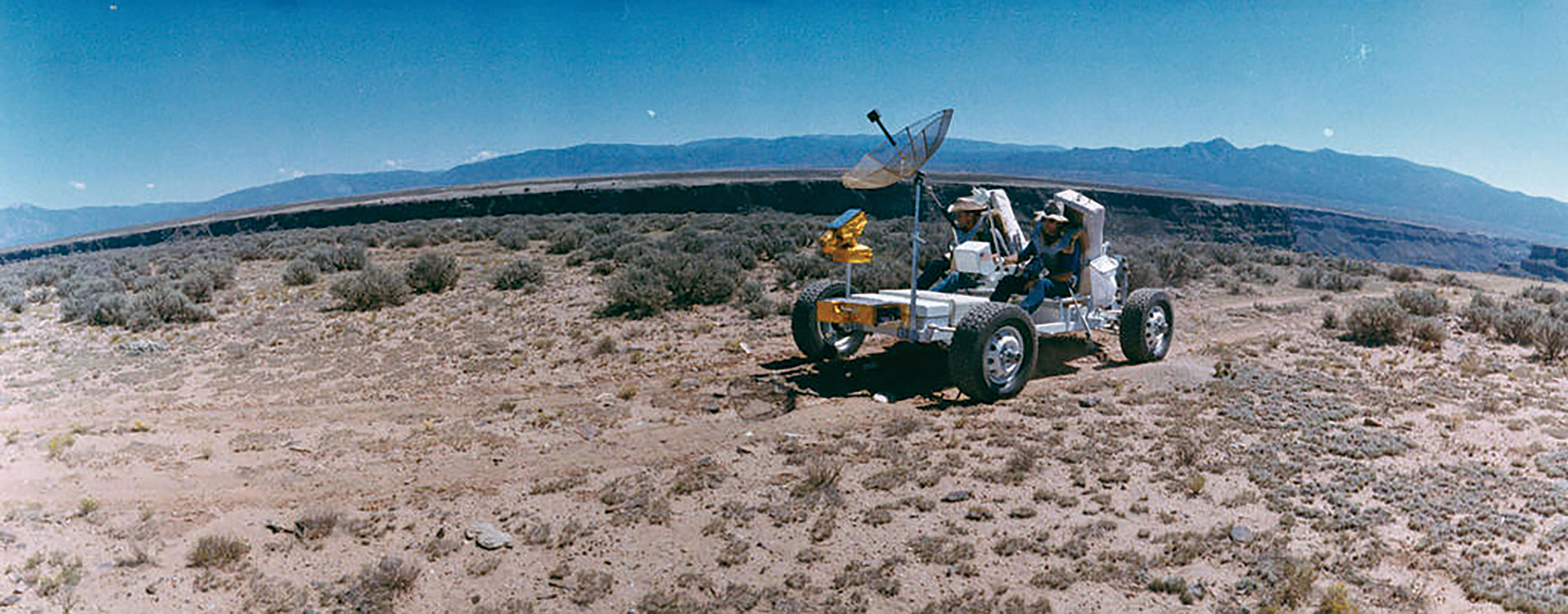 Apollo astronauts Charlie Duke (left) and John Young (right) test drive GROVER (geological rover), an early version of the lunar rover, in Coconino County circa 1965; Photo courtesy Center of Astrogeology, U.S. Geological Survey