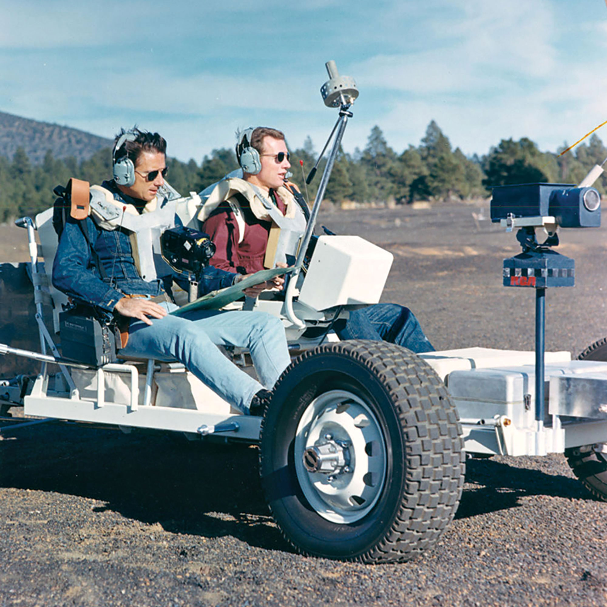 astronauts James Irwin (left) and David Scott (right) drive GROVER at Cinder Lake