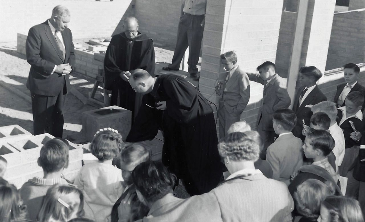 Governor Ernest McFarland and Reverend E. Alexander Gray watch as Reverend Herschel Hedgpeth lays cornerstones for the church's new school, 1955; Photo courtesy Desert Southwest Conference of the United Methodist Church