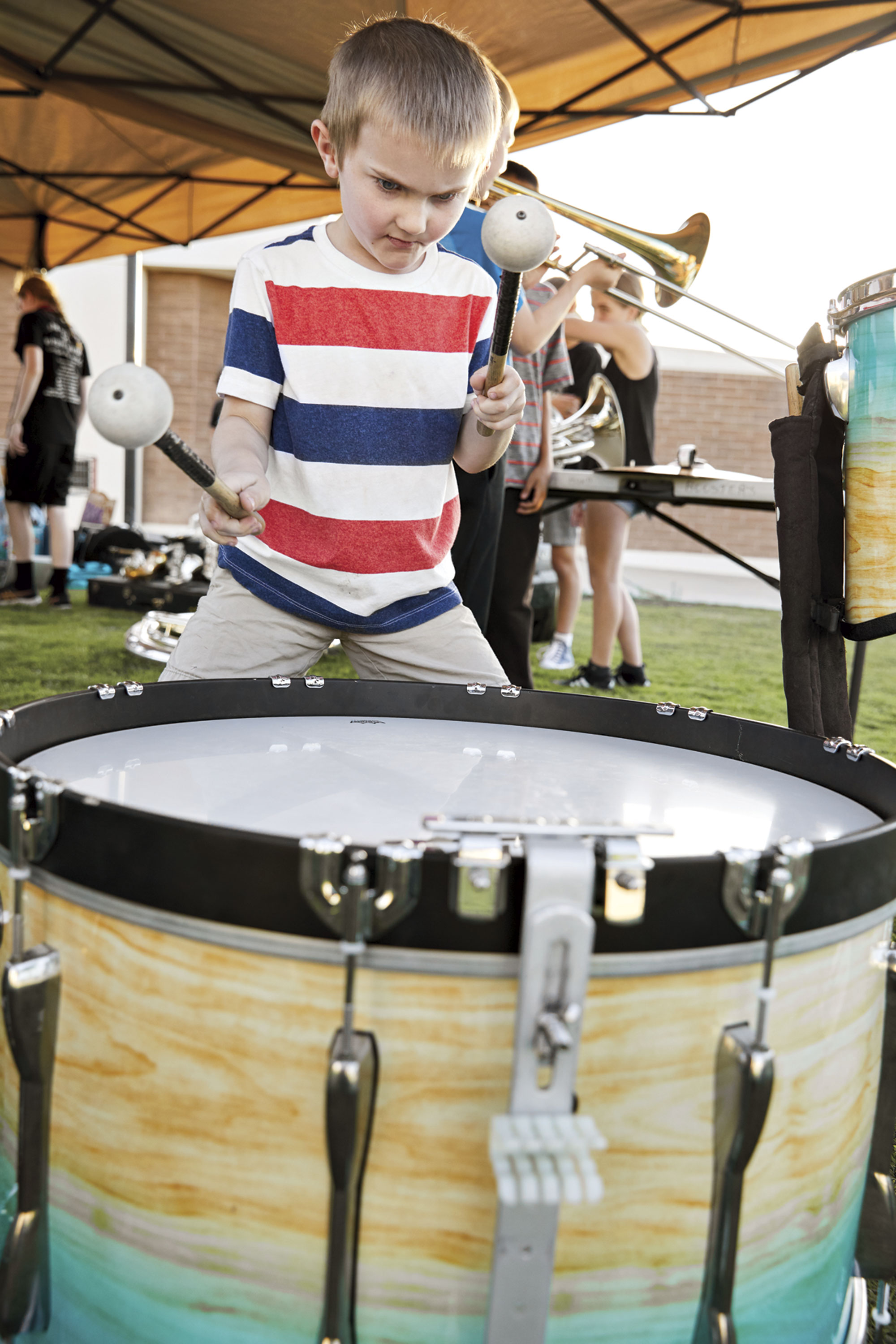 """playing the timpani drums during a spring arts fair at Shadow Mountain High School; Photo by Matt """"Martian"""" Williams"""