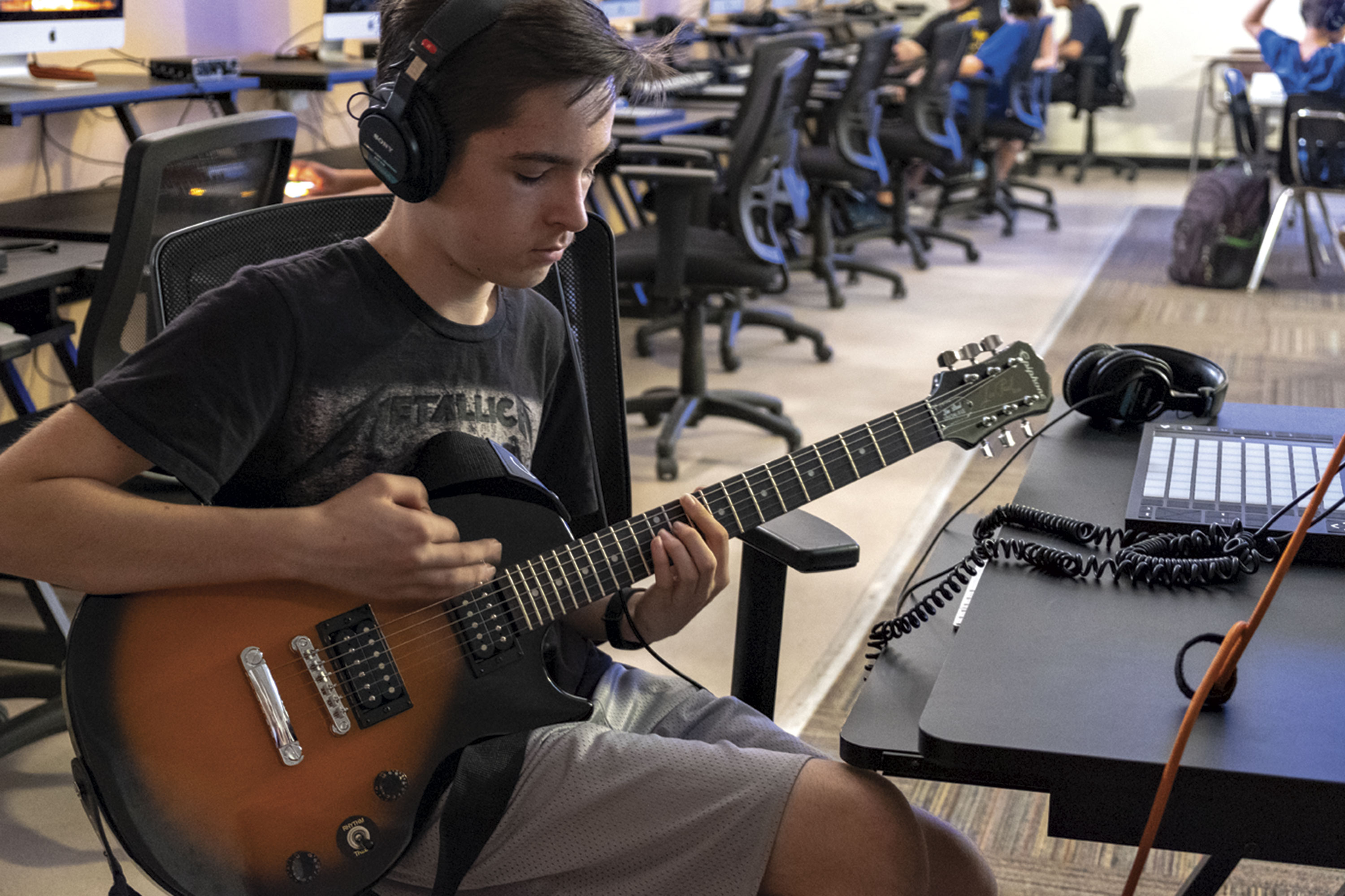 student Maxx Wallace jams on the system.