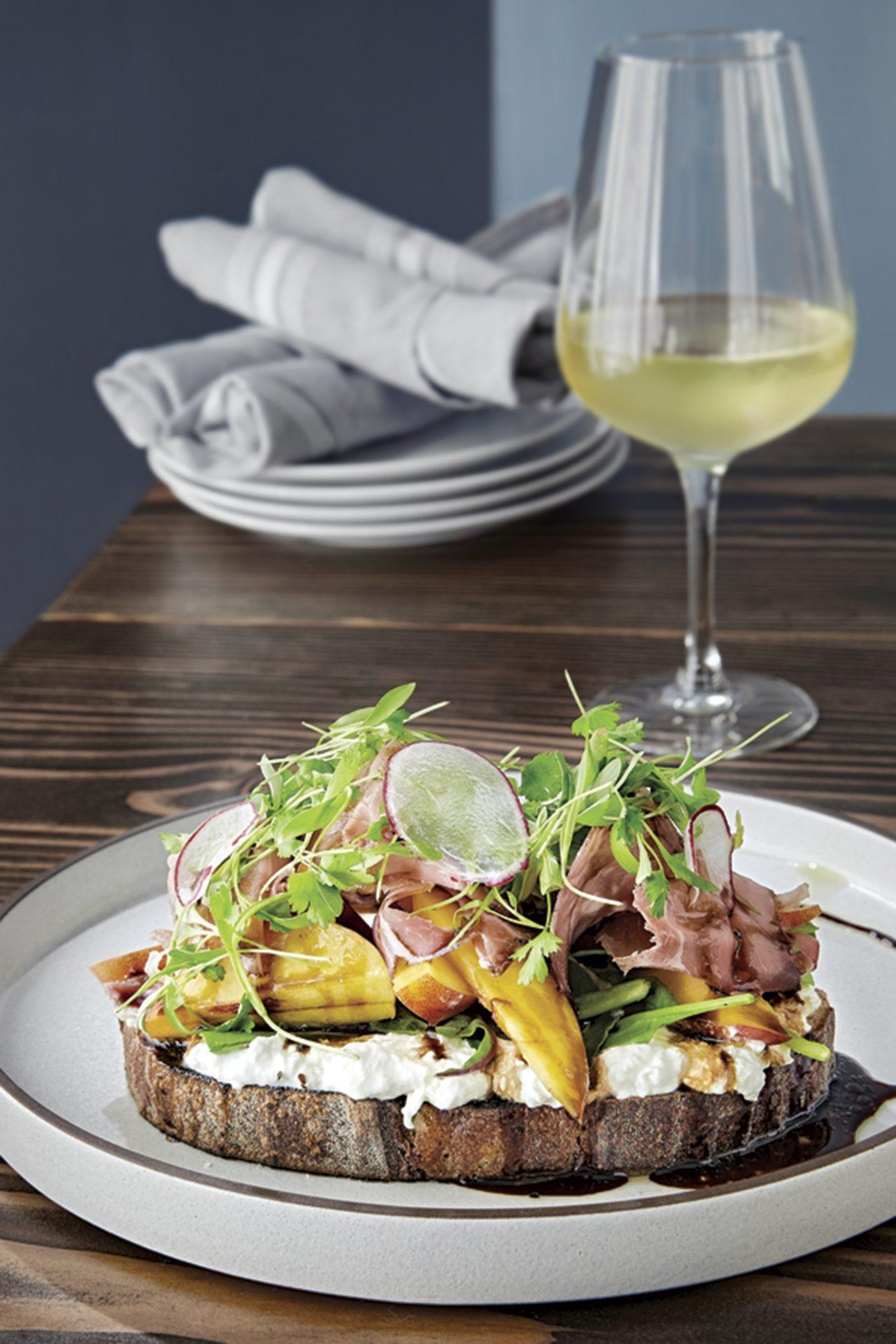 toast with burrata, prosciutto and peaches