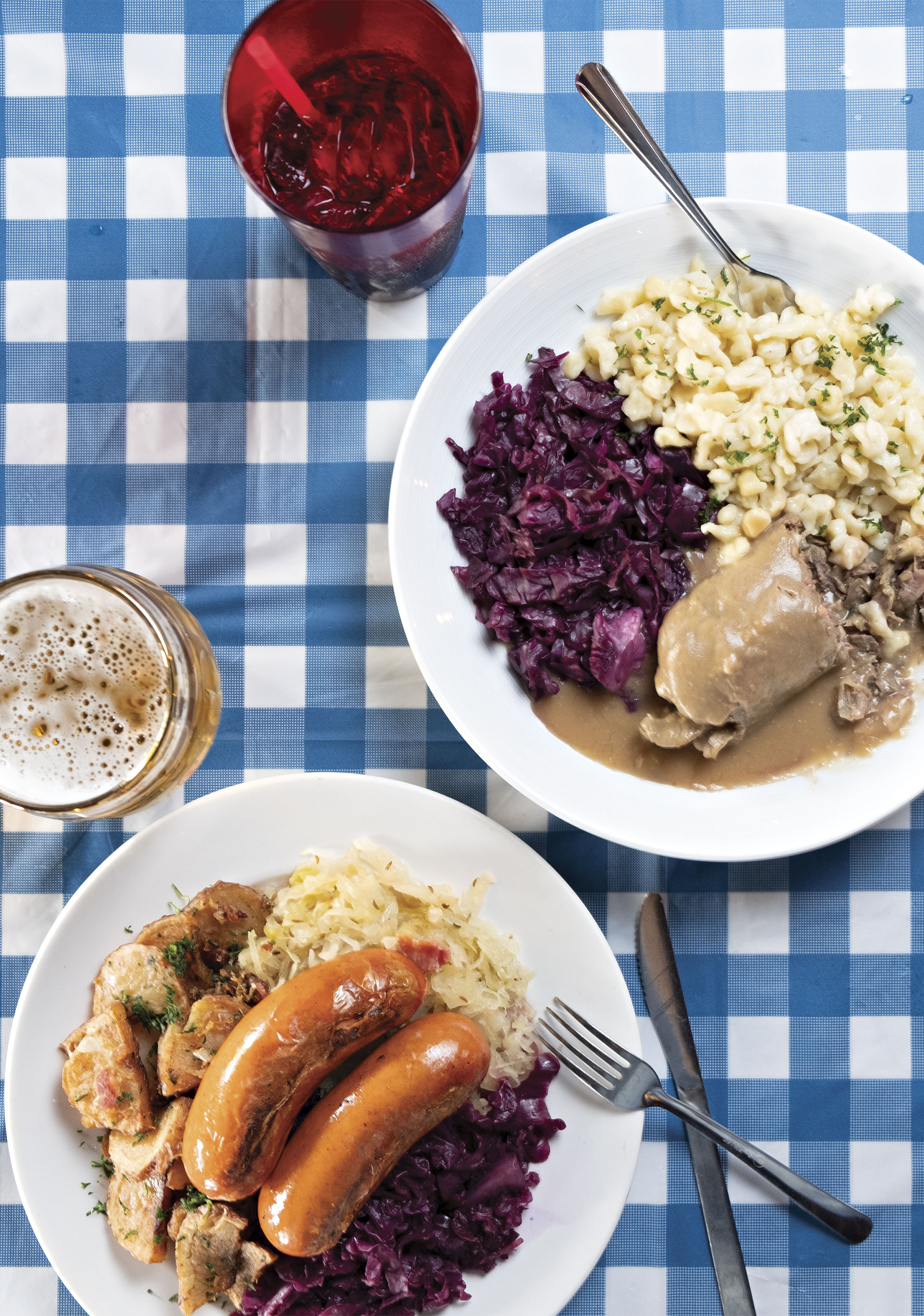 Knockwurst (left) and rinderrouladen plates at Edelweiss Biergarten; Photo by Mirelle Inglefield