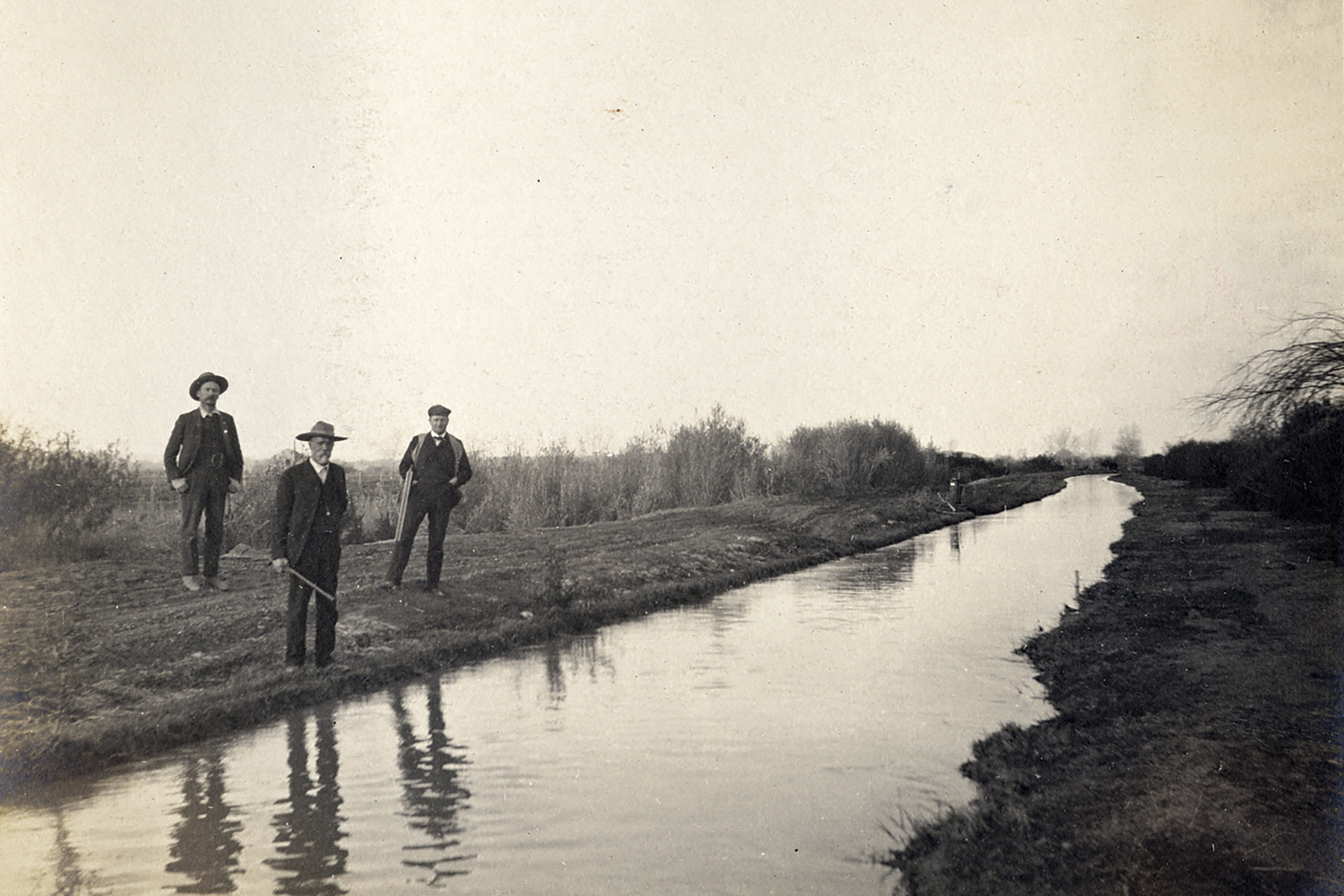 Men standing along one of Phoenix's canals around the same time that the waterlogged corpse of U.S. agent Paul E. Reynolds was fished out of a cross canal in northwest Phoenix; Photo courtesy SRP