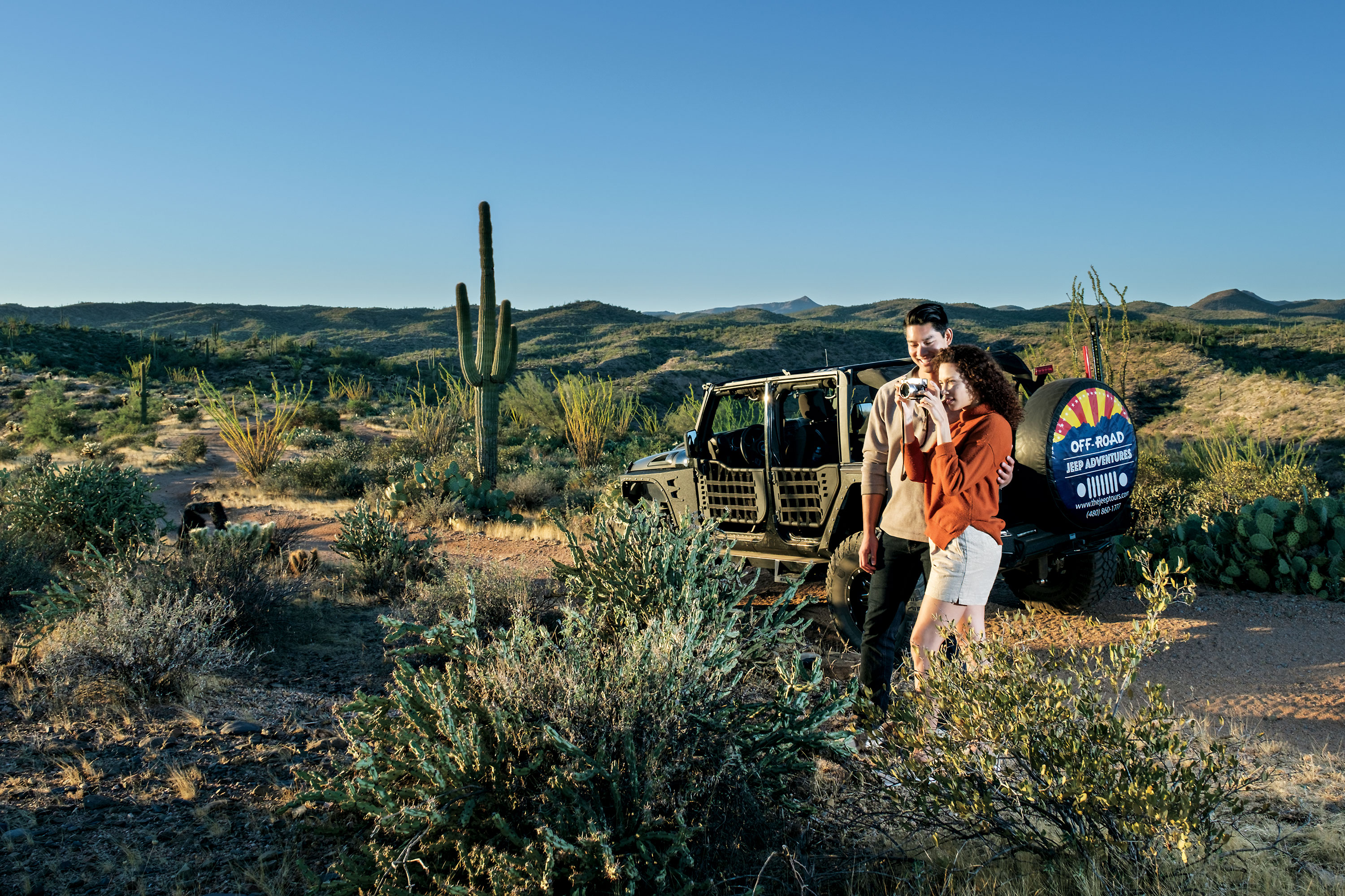 Desert Jeep/Hummer Tours; Photo by Michael Woodall; models: Dominique Taylor & Derek Eligio/Ford Robert Black Agency