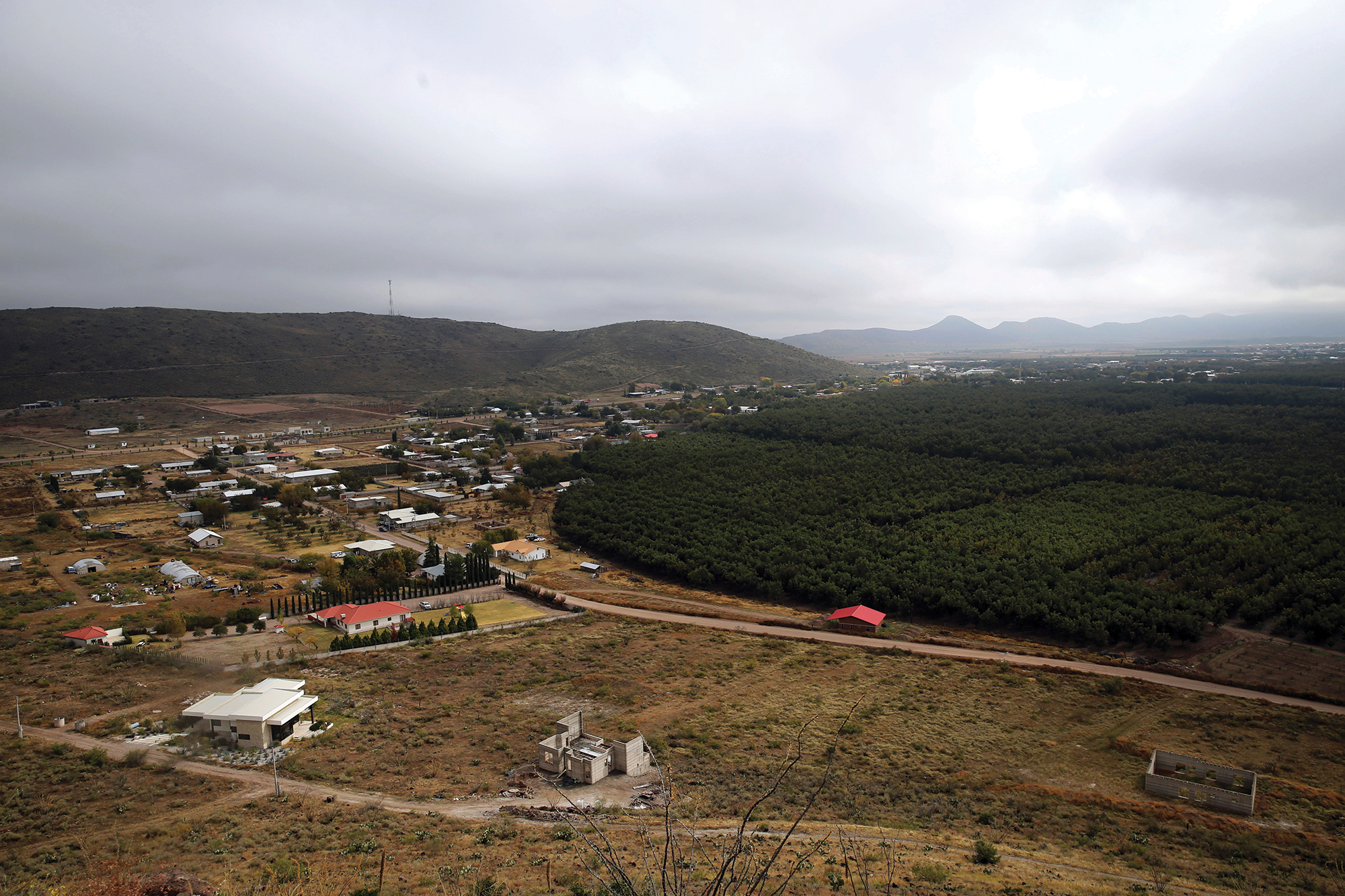 The aerial view of Colonia LeBaron, Mexico, where family and friends of shooting victim Christina Langford Johnson gathered for a funeral service on Saturday, November 9. Johnson was one victim of a cartel ambush that claimed nine lives. In the attack, Langford Johnson jumped out of her vehicle and waved her hands to show she was no threat to the attackers and was shot twice in the heart, community members say. Her 7-month-old daughter, Faith Marie Johnson, was found unharmed in her car seat.; Photo by Marco Ugarte/AP Images