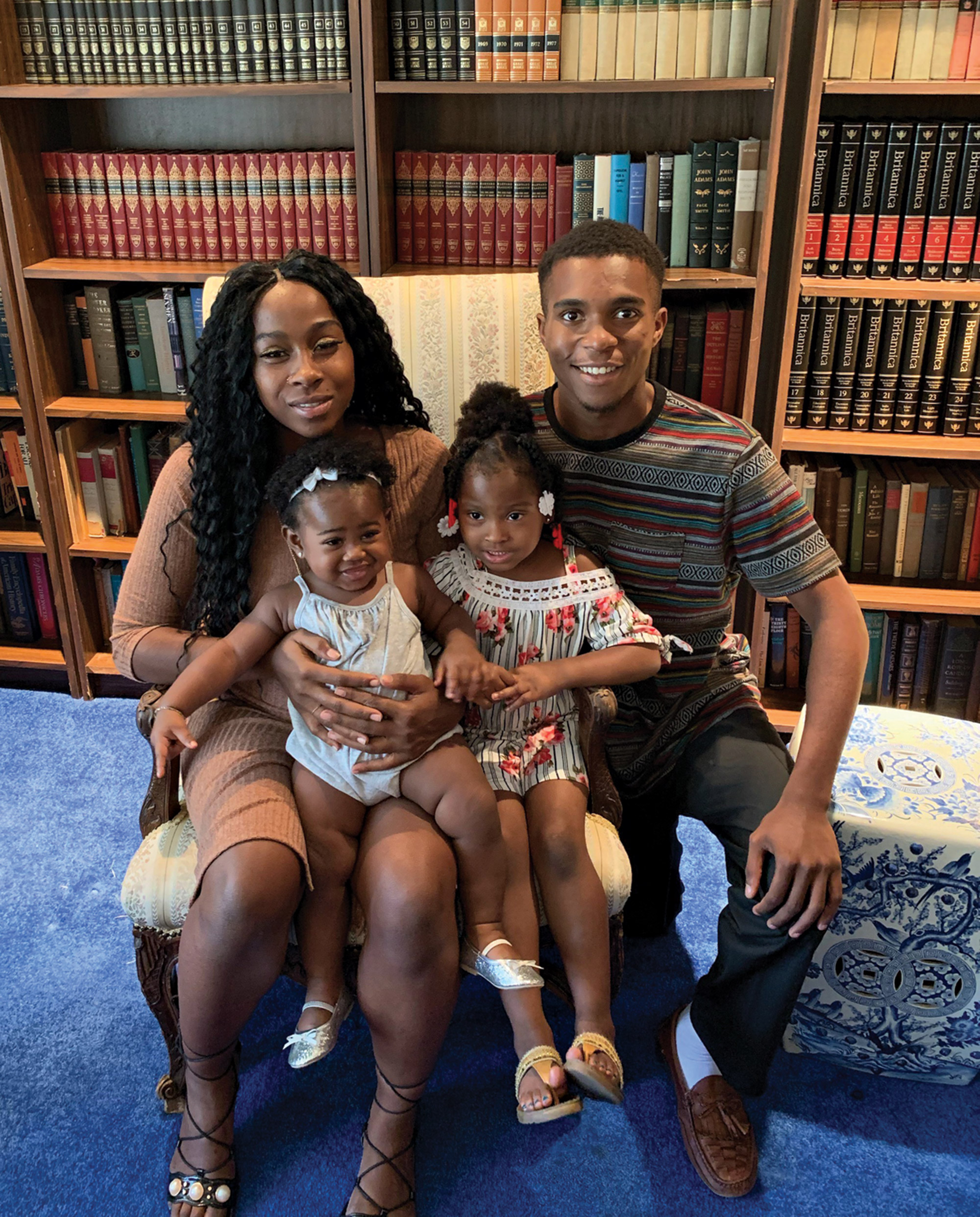 Iesha Harper and Dravon Ames with their daughters, London, left, and Island; Photo courtesy Jarrett Maupin