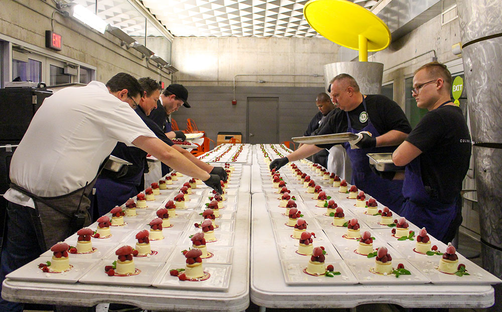 M Culinary chefs building desserts for an event.