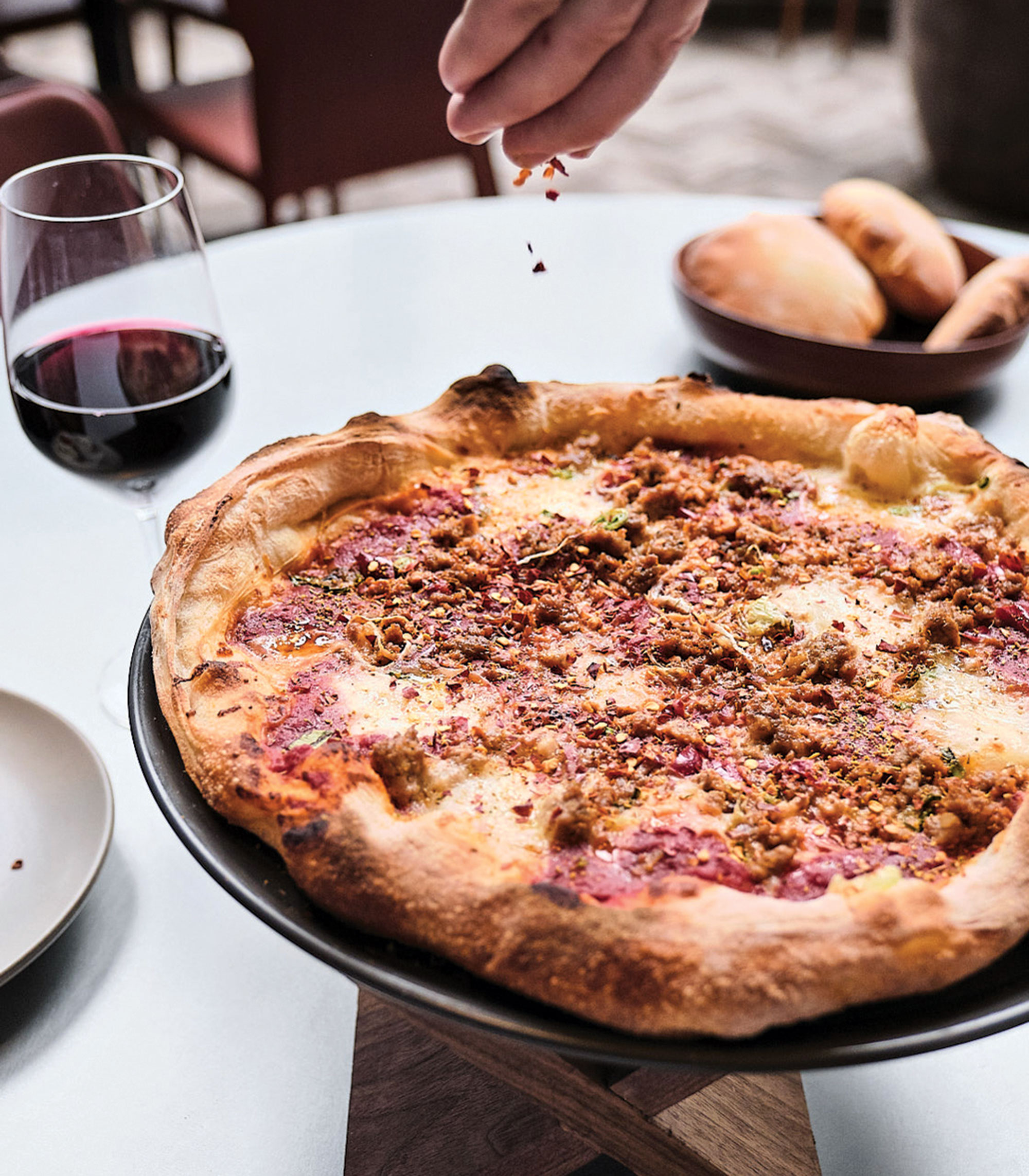 fennel sausage pizza; Photography by Kyle Ledeboer