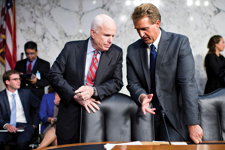 Flake with fellow U.S. Senator John McCain in Washington, D.C., 2013; Photo courtesy Flake family