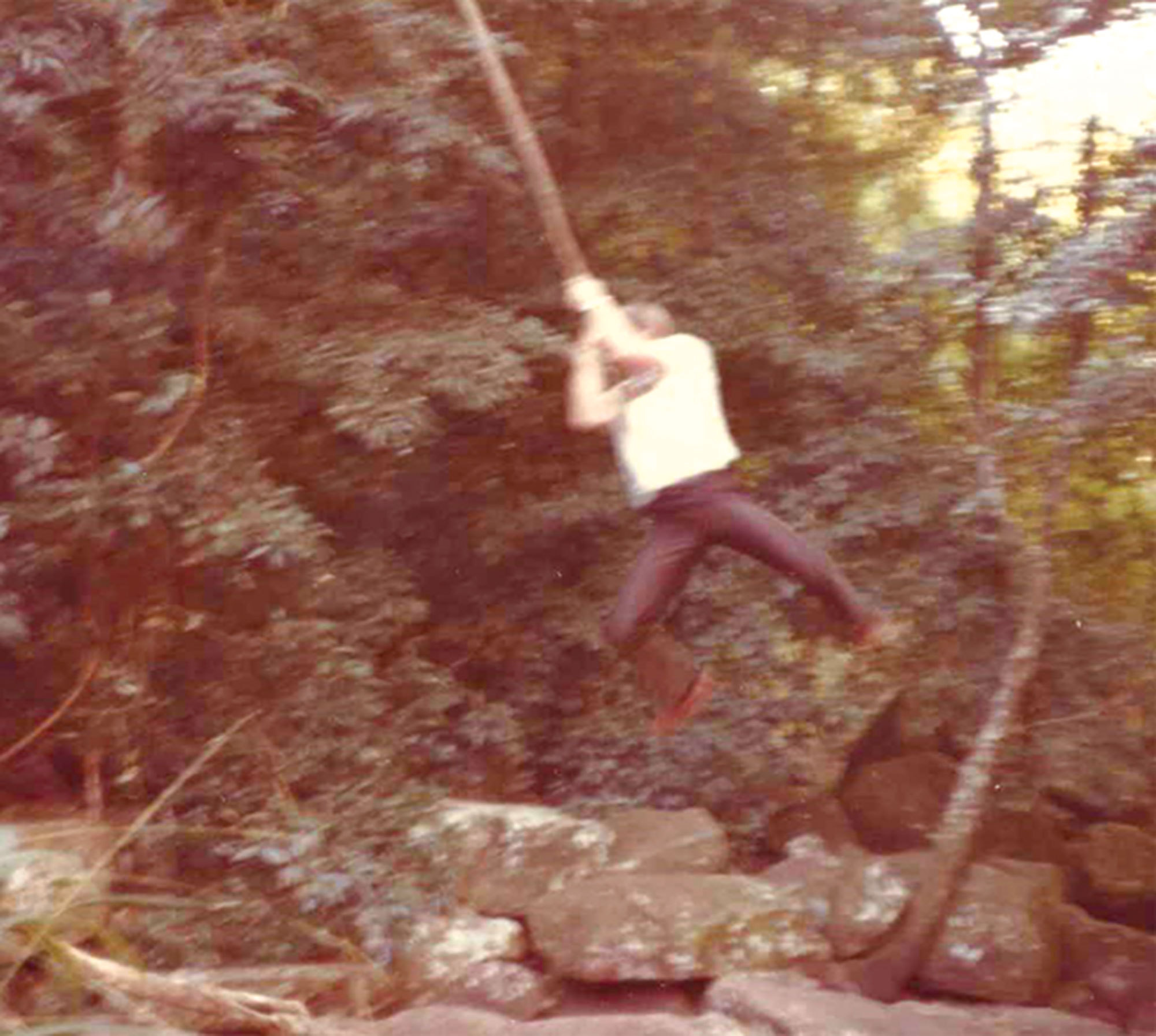 swinging from a vine on his LDS mission in Africa, circa early 1980s; Photo courtesy Flake family
