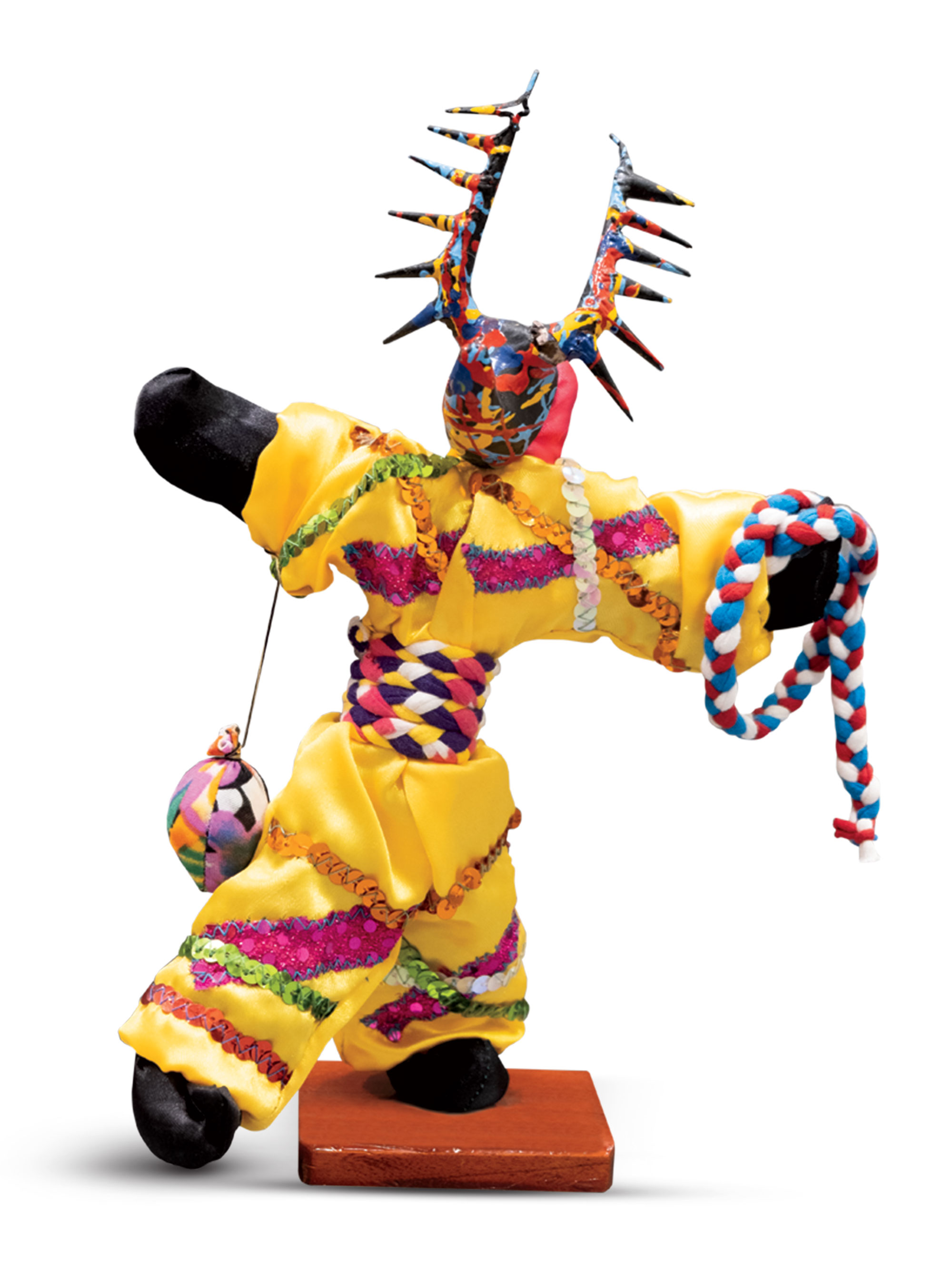 Made of textiles, wood and papier-mâché, this vibrant figurine represents a figure in a Dominican Republic carnival. Andres obtained it during a 2015 mission trip to Santo Domingo. The piece signals if a patient room is occupied.