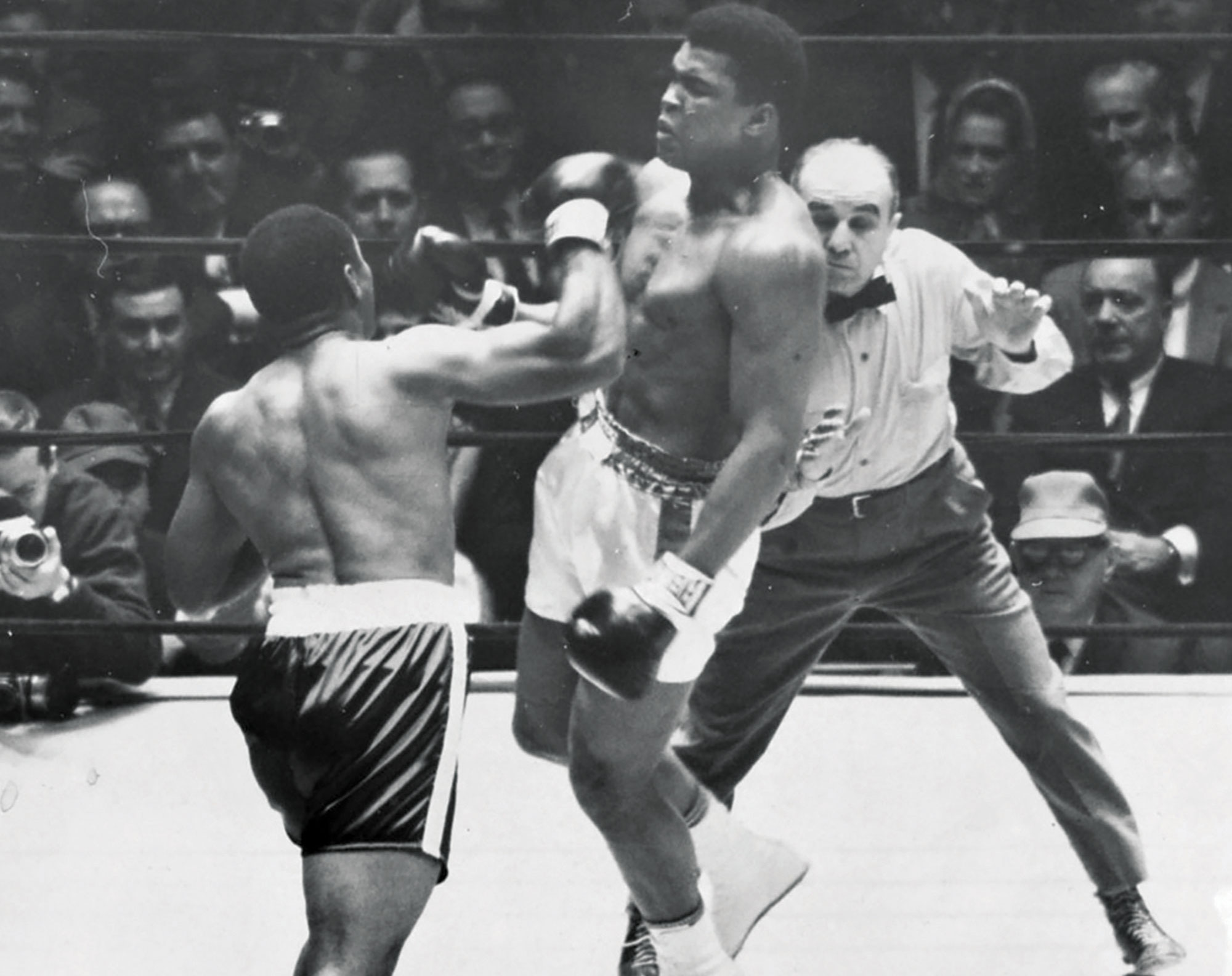 Folley throws a punch at Ali; Photo courtesy Chandler Museum